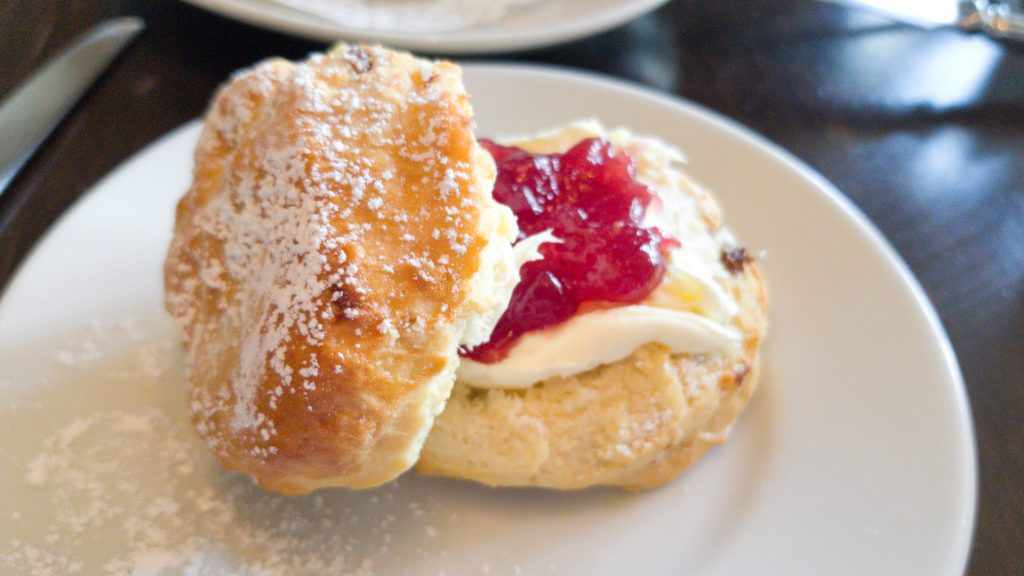 A plain scone served by hotel du vin as a part of their afternoon tea. Served with strawberry jam and clotted cream on the side.