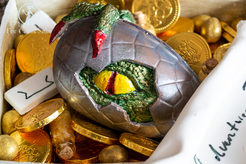 Chocolate egg with baby dragon emerging.