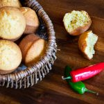 Cornbread muffins made with buttermilk served in a basket