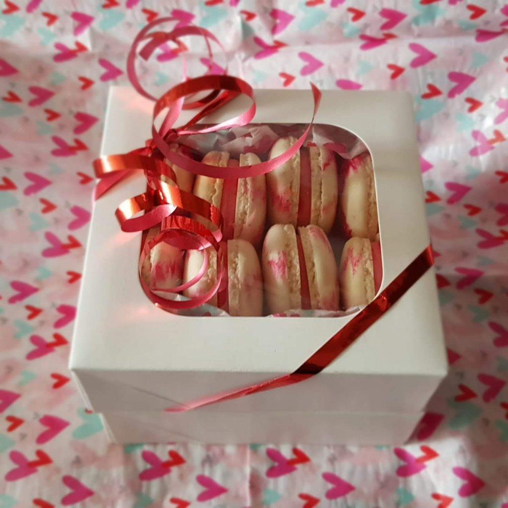 A gift box of eight raspberry ripple macarons.
